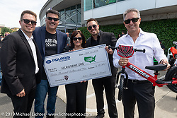 Steve Menneto, the president of motorcycles for Polaris Industries (including Indian) presented a check for $12,000 to Beverly Ness and the Ness family in Arlen's name to pay for Strider Balance bikes for kids in Arlen's Minnesota home town at the Arlen Ness Memorial - Celebration of Life at the Arlen Ness Motorcycles store. Dublin, CA, USA. Saturday, April 27, 2019. Photography ©2019 Michael Lichter.