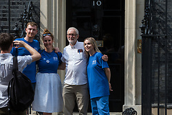 London, UK. 20th July, 2021. NHSPay15 campaigners, including Matthew Tovey (l), pose outside 10 Downing Street with former Labour Party leader Jeremy Corbyn after presenting a petition signed by over 800,000 people calling for a 15% pay rise for NHS workers. At the time of presentation of the petition, the government was believed to be preparing to offer NHS workers a 3% pay rise in 'recognition of the unique impact of the pandemic on the NHS'.