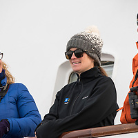 Naturalist Katie Crafts speaks with guests on the bow of the National Geographic Explorer in Antarctica.