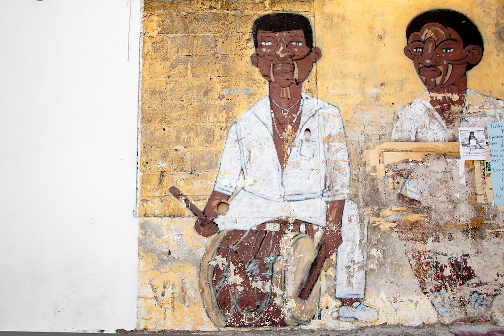 Street art of a painted mural on a old wall of two Afro-American musicians found in the old town of Cartegena.