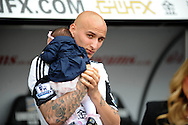 Swansea City's Jonjo Shelvey taking a walk around the pitch along with staff and player at full time as way of thanks to the loyal fans.<br /> Barclays Premier league match, Swansea city v Southampton at the Liberty stadium in Swansea, South Wales on Saturday 3rd May 2014.<br /> pic by Phil Rees, Andrew Orchard sports photography.