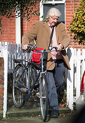 © Licensed to London News Pictures. 05/10/2020. London, UK. STANLEY JOHNSON, father of British Prime Minster Boris Johnson, is seen riding a bike away from his London home. Mr Johnson, who has come under criticism for recently not wearing a face mask, has featured in a book titled The Gambler, by author Tom Bower. Photo credit: Ben Cawthra/LNP