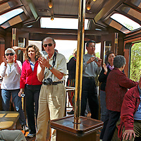 South America, Peru. Travelers enjoying the bar car of the Hiram Bingham luxury train to Machu Picchu.