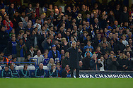 José Mourinho, the Chelsea Manager acknowledges the Chelsea crowd as they chant his name during the 2nd half. UEFA Champions League group G match, Chelsea v Maccabi Tel Aviv at Stamford Bridge in London on Wednesday 16th September 2015.<br /> pic by John Patrick Fletcher, Andrew Orchard sports photography.