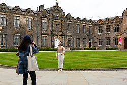 St Andrews, Scotland, UK. 7 September, 2020. Freshers Week starts at the University of St Andrews in Fife. Overseas and domestic students are arriving in the town this week. Many students are accompanied by their parents and were exploring the ancient university campus and the major attractions in the town. Pictured;  Chinese students in St Salvator's Quad.  Iain Masterton/Alamy Live News