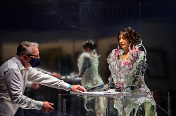 © Licensed to London News Pictures. 17/09/2021. LONDON, UK. A staff member checks Paula Sello and Alissa Aulbekova's fashion house Auroboros showcase, a real-time growing couture gown worn by Ai-Da, the world's first artist robot, that will grow and fall apart during the festival whilst Ai-Da draws a self-portrait that can be experienced virtually. Launch of this year's London Design Festival at the V&A Museum in South Kensington.  Installations, projects, performances and events explore design thinking in the challenge of climate change. Photo credit: Stephen Chung/LNP