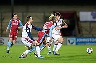 Scunthorpe United Devarn Green (14) is pushed in the back during the EFL Sky Bet League 2 match between Scunthorpe United and Bolton Wanderers at the Sands Venue Stadium, Scunthorpe, England on 24 November 2020.