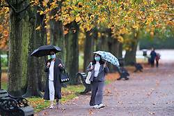 ©Licensed to London News Pictures 29/10/2020  <br /> Greenwich, UK. People walking in Greenwich Park, London. October is set to be the wettest month in years as an Atlantic storm brings wet and windy weather to parts of the UK today. Photo credit:Grant Falvey/LNP