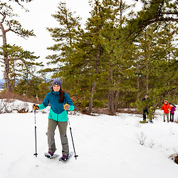 Snowshoeing near the summit at Loon Echo Land Trust's Bald Pate Mountain Preserve in South Bridgton, Maine.