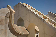 The Jantar Mantar, Jaipur, is an astronomical observation site built in the early 18th century photographed on 4th February 2018 in Jaipur, Rajasthan, India. The Jantar Mantar is a collection of 19 astronomical instruments built by the Rajput king Sawai Jai Singh II, the founder of Jaipur, Rajasthan. The instruments allow the observation of astronomical positions with the naked eye. The observatory is an example of the Ptolemaic positional astronomy which was shared by many civilizations.The monument was completed in 1734 and features the worlds largest stone sundial. It is now a UNESCO World Heritage site.