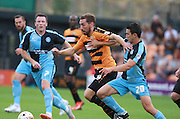 Barnet's Tom Champion shrugs off a challenge from Wycombe Wanderers' Luke O'Nien during the Sky Bet League 2 match between Barnet and Wycombe Wanderers at Underhill Stadium, London, England on 15 August 2015. Photo by Bennett Dean.