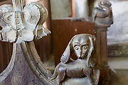 Carved medieval bench ends at All Saints church, South Elmham, Suffolk, England, UK,  a dog with long floppy ears