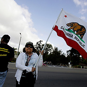 Members of the San Diego Minutemen, an anti illegal immigration group,  protest adjacent to a gathering spot for day laborers. The SDMM harass the latino day laborers in hopes of driving them away from the area. Please contact Todd Bigelow directly with your licensing requests. PLEASE CONTACT TODD BIGELOW DIRECTLY WITH YOUR LICENSING REQUEST. THANK YOU!