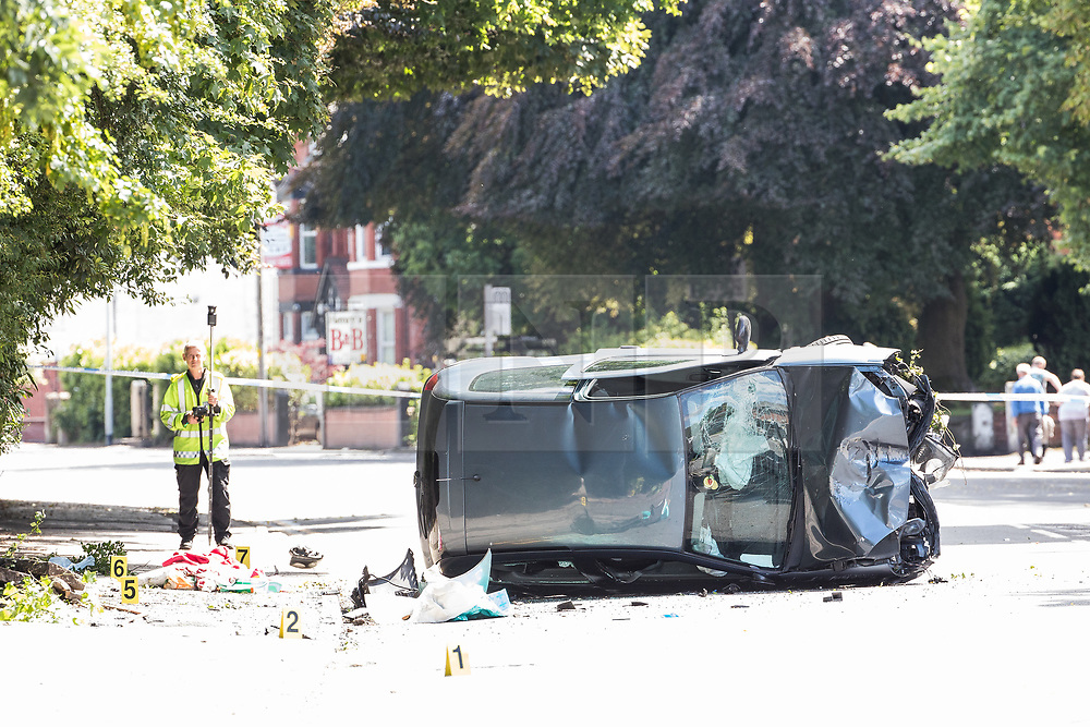 © Licensed to London News Pictures . 16/07/2017 . Manchester , UK .The Independent Police Complaints Commission have been informed following a road traffic accident near Stockport . Reports say a car struck two elderly people on the A6 Buxton Road in Heaviley at the junction with Kennerley Road and that two young males were detained by members of the public and police as they tried to make off from the scene . An undamaged silver BMW and a badly damaged dark grey Renault Clio were towed from the scene and surrounding roads have been closed to traffic as an investigation is carried out . Photo credit : Joel Goodman/LNP