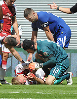 Football - 2017 Community Shield - Chelsea vs. Arsenal<br /> <br /> Per Mertesacker of Arsenal lies on the ground with Blood coming from his head after clashing with Gary Cahill of chelsea and as a result had to be substituted.<br /> Petr Cech stands over him at Wembley.<br /> <br /> COLORSPORT/ANDREW COWIE