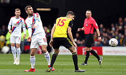 Crystal Palace's James McArthur (left) and Watford's Craig Cathcart battle for the ball during the FA Cup quarter final match at Vicarage Road, Watford.