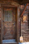 Typical Swiss wooden chalet style house with straw brush in Serneus near Klosters in Graubunden region, Switzerland