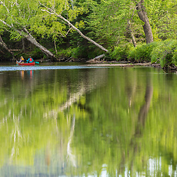 Two women paddling a canoe on the West Branch of the Pleasant River near Silver Lake in Piscataquis County, Maine. Near Greenville.