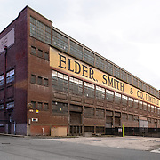 Port Adelaide, Australia, (SA): Exterior view of the Factory Elder Smith & Co at Port Adelaide. The first wool store to be erected was Elder Smith & Co's in 1880 and directly opposite the newly opened Port Adelaide Dock by Doklands. Photographs by Alejandro Sala   Visit Shop Images to purchase and download a digital file and explore other Alejandro-Sala images…