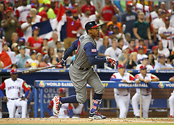 March 11, 2017 - Miami, FL, USA - The United States' Adam Jones reaches on a fielding error by Dominican Republic center fielder Starling Marte, allowing a run to score, during the third inning in a World Baseball Classic first round Pool C game at Marlins Park in Miami on Saturday, March 11, 2017. (Credit Image: © David Santiago/TNS via ZUMA Wire)