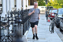 © Licensed to London News Pictures. 20/06/2019. London, UK. MICHAEL GOVE MP is seen leaving his London home the morning after surviving the latest round of voting in the conservative leadership race.. Further candidates are expected to drop out of the race to be the next Prime Minister over the next two days, leaving two, in a series of votes held by Conservative MPs at Parliament. Photo credit: Ben Cawthra/LNP