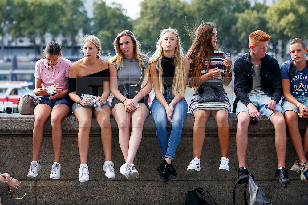 © Licensed to London News Pictures. 08/09/2016. London, UK. Young people enjoy warm weather and sunshine in Southbank, London on Thursday, 8 September 2016.  Photo credit: Tolga Akmen/LNP
