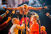 """A monk lies on upheld spear points - Twenty Shaolin monks, from their  temple in the foothills of the Song Shang mountain range in China's Henan province, take to the stage to demonstrate their martial arts expertise in an 'awe-inspiring' performance. SHAOLIN is a display of theatre and physical prowess in which the cast perform """"superhuman"""" feats. The show combines traditional Shaolin Kung Fu, inch perfect choreography with dramatic lighting and sound that evokes the spirit of their tradition – their Temple being the birthplace of Kung Fu.  These are the very best Shaolin Kung Fu experts on the planet and they have come together to create this show. The Shaolin Monks are lifted aloft on sharpened spears, break marble slabs with their heads, perform handstands on two finger tips,splinter wooden staves with their bodies, break bricks on their heads and fly through the air in a series of incredible back flips. The show embarks upon a three-week run at The Peacock Theatre, London from 29 September – 17 October 2015."""