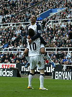 Photo: Andrew Unwin.<br />Newcastle United v Tottenham Hotspur. The Barclays Premiership. 01/04/2006.<br />Tottenham's Robbie Keane (#10) celebrates his goal with Aaron Lennon.