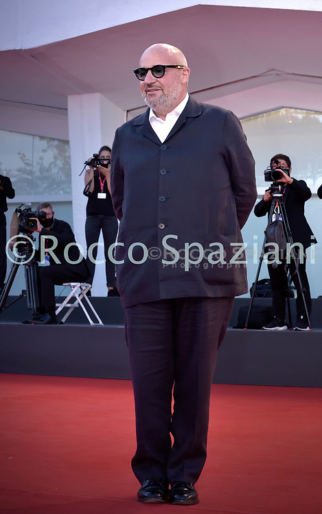 """VENICE, ITALY - SEPTEMBER 08:Gianfranco Rosi,  walks the red carpet ahead of the movie """"Notturno"""" at the 77th Venice Film Festival on September 08, 2020 in Venice, Italy.  <br /> (Photo by Rocco Spaziani)"""
