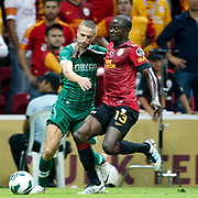Galatasaray's Dany Nounkeu (r) and Bursaspor's Stanislav Sestak during their Turkish Super League soccer match Galatasaray between Bursaspor at the TT Arena at Seyrantepe in Istanbul Turkey on Sunday 02 September 2012. Photo by TURKPIX