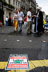 "LONDON 22 July 2006. Over 7,000  people joined a street protest against Israel's attacks on Lebanon.. ""The Israeli assault is now spreading to all regions including the mountains and the north. The damage is enormous and the death toll is rising. This only indicates the scale of the attacks and the advanced weaponry the Israelis are using. Only looking at the infrastructure ruins you can see how powerful they are. We are under siege from all directions - air, sea and land."" Eyewitness account from a socialist in Lebanon.PHOTO © KASH GT.Distribution NORTH & SOUTH AMERICA ONLY"