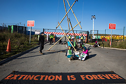 Anti-HS2 activists use arm tube lock-ons and a tripod to block one of several entrances blocked to the Chiltern Tunnel South Portal site for the HS2 high-speed rail link on 9 October 2020 in West Hyde, United Kingdom. The protest action, at the site from which HS2 Ltd intends to drill a 10-mile tunnel through the Chilterns, was intended to remind Prime Minister Boris Johnson that he committed to remove deforestation from supply chains and to provide legal protection for 30% of UK land for biodiversity by 2030 at the first UN Summit on Biodiversity on 30th September.