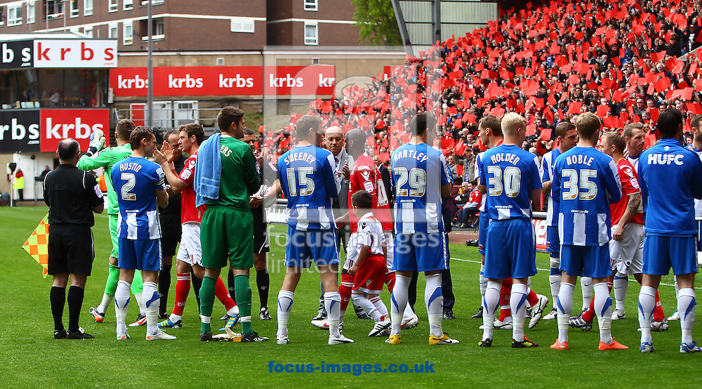 Picture by John Rainford/Focus Images Ltd. 07506 538356.05/05/12.Charlton Athletic walk out onto the pitch through a guard of honour formed by Hartlepool United before the Npower League 1 match at The Valley stadium, London.