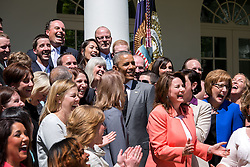 President Barack Obama joins Shanna Peeples, the 2015 National Teacher of the Year, and 2015 State Teachers of the Year for a group photo in the Rose Garden of the White House, April 29, 2015. (Official White House Photo by Pete Souza)<br /> <br /> This official White House photograph is being made available only for publication by news organizations and/or for personal use printing by the subject(s) of the photograph. The photograph may not be manipulated in any way and may not be used in commercial or political materials, advertisements, emails, products, promotions that in any way suggests approval or endorsement of the President, the First Family, or the White House.