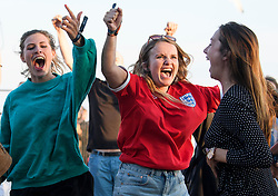 © Licensed to London News Pictures. 03/07/2018. Brighton, UK. Celebrations for the first goal. England fans watch the the World Cup second round match between England and Colombia on a big screen on Brighton beach, on the south coast of England. Photo credit: Ben Cawthra/LNP