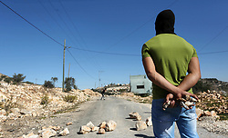 November 2, 2018 - Nablus, West Bank, Palestinian Territory - A Palestinian protester carries stones during clashes with Israeli forces following a weekly demonstration against the expropriation of Palestinian land by Israel in the village of Kfar Qaddum, near the West Bank city of Nablus on November 2, 2018  (Credit Image: © Shadi Jarar'Ah/APA Images via ZUMA Wire)