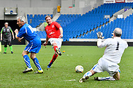 Goal - Peter Stacey of England over 60's scores a goal to give a 3-0 lead to the home team and complete his hatrick during the world's first Walking Football International match between England and Italy at the American Express Community Stadium, Brighton and Hove, England on 13 May 2018. Picture by Graham Hunt.