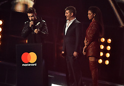 Liam Payne with the Best British Video Award with Simon Cowell and Nicole Scherzinger on stage at the BRIT Awards 2017, held at The O2 Arena, in London.<br />