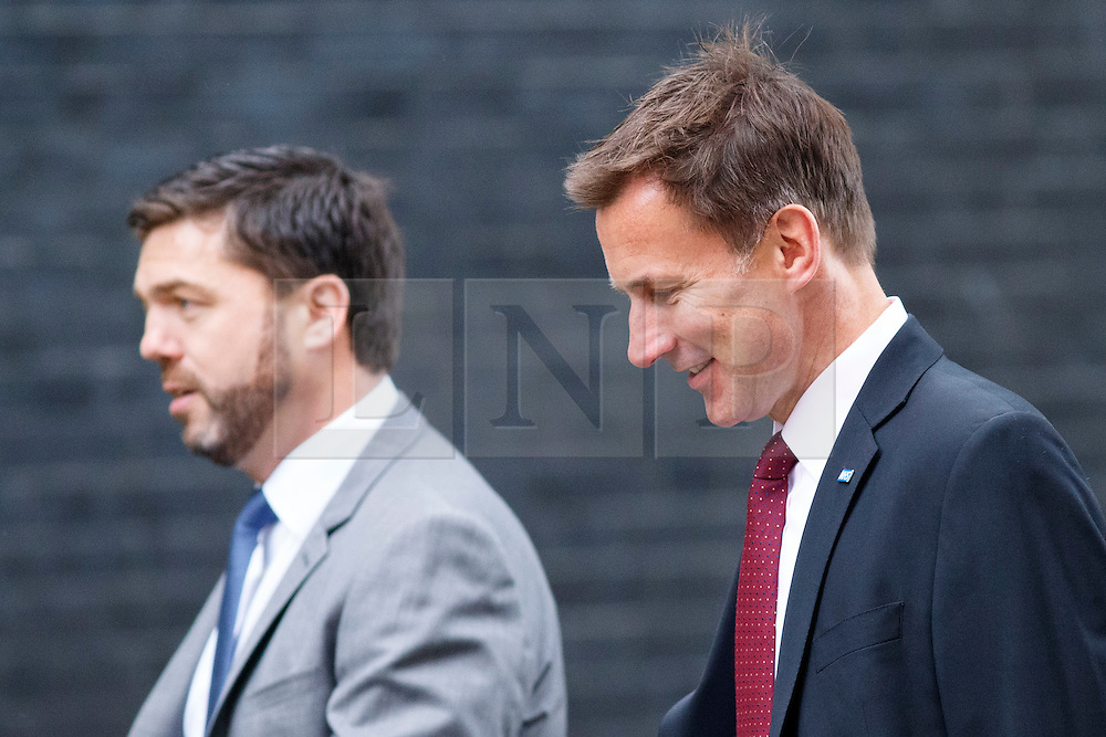 © Licensed to London News Pictures. 09/06/2015. Westminster, UK. Wales Secretary STEPHEN CRABB and Health Secretary JEREMY HUNT attending to a cabinet meeting in Downing Street on Tuesday, 9 June 2015. Photo credit: Tolga Akmen/LNP