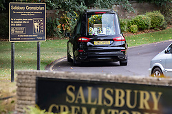 © Licensed to London News Pictures. 30/07/2018. Salisbury, UK. A hearse carrying the coffin, with the word MUM in flowers inside, arrives at Salisbury Crematorium for the funeral of Dawn Sturgess, who died on 8 July 2018 after exposure to the nerve agent Novichok. Special safety measures have been put in place to protect mourners attending the ceremony. Photo credit: Peter Macdiarmid/LNP