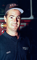 14 September 2001. New York, New York - USA.<br /> Post 9/11 World Trade Center attack.<br /> Mike Kehoe, Hero firefighter of Engine 28, Ladder 11 pictured at his firehouse on East 2nd Street in the East village early in the morning of Sept 14th. <br /> Mike's image had been published the day before on front pages around the world. It is the iconic image of him ascending the stairs of the World Trade Center as he helped to evacuate people from the terrorist attacks of 9/11. It was assumed Mike had perished when the buildings collapsed. However Mike had miraculously managed to escape the buildings moments before they collapsed. 6 members of his crew were not so fortunate. Mike became a symbol of heroism to many following the vicious Al Queda attacks which claimed over 2,000 victims at the WTC site. This images was published exclusively on the Front Page of the Daily Mirror on 15th Sept, 2001.<br /> Photo exclusive©; Charlie Varley/varleypix.com
