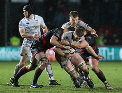 Ospreys' Bradley Davies under pressure from Dragons' Ben Roach<br /> <br /> Photographer Simon King/Replay Images<br /> <br /> Guinness Pro14 Round 12 - Dragons v Cardiff Blues - Sunday 31st December 2017 - Rodney Parade - Newport<br /> <br /> World Copyright © 2017 Replay Images. All rights reserved. info@replayimages.co.uk - http://replayimages.co.uk