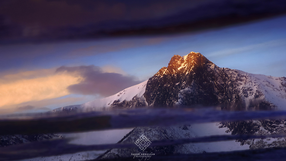 I can not stop searching for the mountains and observing the light that is shine on its peaks.<br /> In Senja, Norway, the reflection of this summit on a spot of water overlaps with parts of the surface saying: Despite the cracks, I will remain proud!