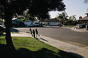 Samantha Olivarez, 9, from left, and her cousins, Isabel Olivarez, 5, and Daisy Olivarez, 7, play in front of their home in Arvin, Calif. The homes across the street from Olivarez were evacuated after a gas pipe leaked underground. According to reports, the 40-year-old pipe was leaking for a long as two years before it was detected. Olivarez's family is worried about possible health risks in the area due to the pollution.