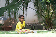 India, Rajasthan, Udaipur Saheliyon Ki Bari gardens, built for the women of Maharana Sangram Singh II in the 18th century. A young Indian girl in the garden