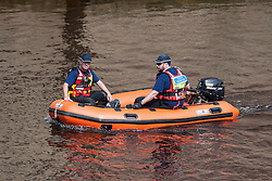 © Licensed to London News Pictures. 10/07/2016. <br /> Members of a search and rescue team, search for a man seen falling from a bridge into the River Ouse in York on Sunday 10th July 2016 . Photo credit: Max Bryan/LNP