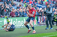 Keith Earls (#11) of Munster Rugby celebrates after scoring a try during the Heineken Champions Cup quarter-final match between Edinburgh Rugby and Munster Rugby at BT Murrayfield Stadium, Edinburgh, Scotland on 30 March 2019.