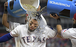 September 8, 2017 - Arlington, TX, USA - Texas Rangers catcher Robinson Chirinos gets a cold bath from teammates Elvis Andrus and Rougned Odor (12) after the Texas Rangers an 11-5 win against the New York Yankees at Globe Life Park in Arlington, Texas, on Friday, Sept. 8, 2017. The Rangers won, 11-5. (Credit Image: © Max Faulkner/TNS via ZUMA Wire)