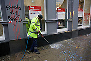 Cleaning up street the morning after the TUC-organised anti-government march against cuts to Britain's economy.