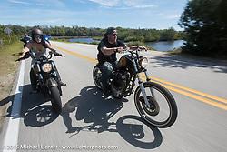 Karlee Cobb rides her custom 2015 Indian Scout beside Austin Andrella on his custom Yamaha XS650 in Tamoka State Park during Daytona Beach Bike Week  2015. FL, USA. Friday, March 13, 2015.  Photography ©2015 Michael Lichter.